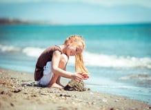 Little girl walks on the  beach Royalty Free Stock Photo