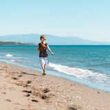 Little girl walks on the  beach Royalty Free Stock Photography