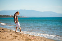Little girl walks on the  beach Stock Photo