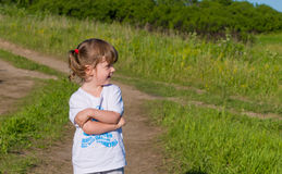 A little girl walks into the field. Royalty Free Stock Photos