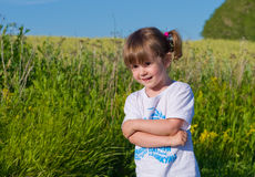 A little girl walks into the field. Royalty Free Stock Image
