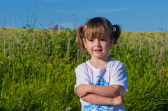 A little girl walks into the field. Royalty Free Stock Photography