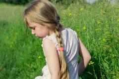 Little girl walks in the field Royalty Free Stock Photo