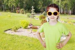 Little girl walks in the garden Royalty Free Stock Photos