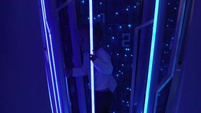 A little girl walks in the museum of the smart city in Moscow. The child is watching the database storage stock video footage