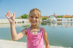 Little girl walks near Lower bridge, Nin, Croatia Royalty Free Stock Photos