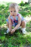 The little girl walks outdoors Stock Image