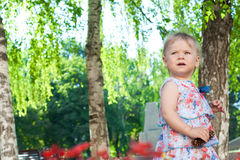The little girl walks outdoors Stock Images