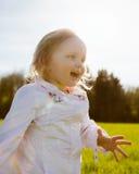 Little girl walks in the park Stock Images