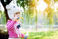 Little girl walks in the park Royalty Free Stock Photo