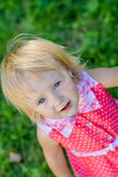 Little girl walks in the park in the summer Stock Photography
