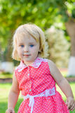Little girl walks in the park in the summer Royalty Free Stock Photo