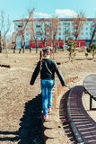 Little girl. Girl walks in the park on a sunny day Stock Photo