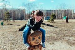 Little girl. Girl walks in the park on a sunny day Stock Photos
