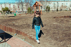 Little girl. Girl walks in the park on a sunny day Royalty Free Stock Image