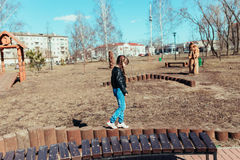 Little girl. Girl walks in the park on a sunny day Royalty Free Stock Photography