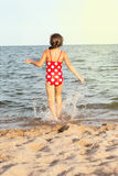 Little girl walks into the sea Royalty Free Stock Photography
