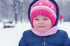 Little girl walks on the street in the winter day.  royalty free stock photo