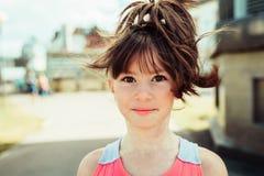 Little girl. Walks in summer city Stock Photos