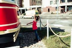 Little girl. Walks in summer city Royalty Free Stock Photo