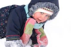 Little girl walks sunny winter day stock images