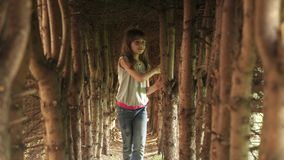 Little girl walks through the tunnel of trees. the child in the mysterious and magical forest