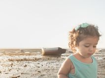 Little girl walking at sunset on the beach Royalty Free Stock Photo
