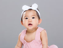 Little girl want to say something. With gray background Royalty Free Stock Image