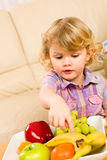 Little girl wants fruit pointing at banana Stock Images