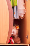 Little girl in wardrobe Stock Images