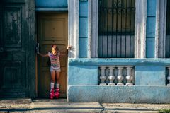 A little girl trys out her roller-blades in the evening sun in Cuba. royalty free stock images