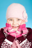 Little girl in warm clothes Stock Images