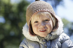 Little Girl In Warm Clothes Smiling At Yard Royalty Free Stock Photos