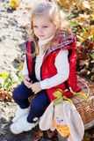 Little girl in warm clothes with toy rabbit Stock Photo