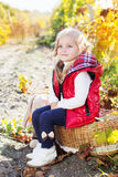 Little girl in warm clothes with toy rabbit Stock Images