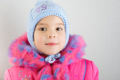 Little girl in warm coat with cap Royalty Free Stock Photo