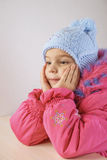 Little girl in warm coat with cap Stock Photography