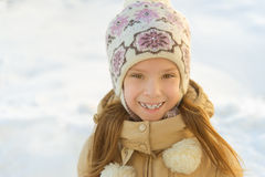 Little girl in warm coat with hood Stock Image