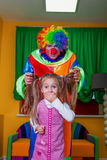 Little girl was frightened of the clown. Stock Photos
