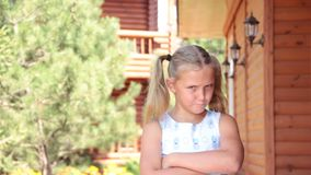 The little girl was offended by nature. Portrait stock video footage