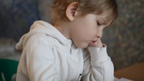 The little girl was upset and upset that the picture does not work.  stock footage