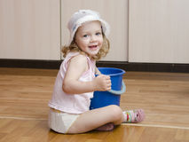 Little girl wash rag floors stock photography