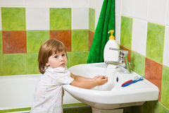 Little girl washes hands. Stock Image