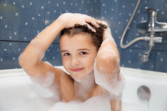 Little Girl Washes Her Head In The Bath Stock Images