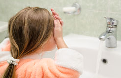 Little girl washing in bath Stock Photo
