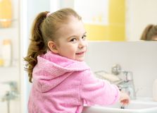 Little girl washing in bathroom Royalty Free Stock Photography