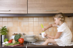 Little girl washing dishes Stock Photography