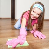 Little girl cleans the house Stock Images
