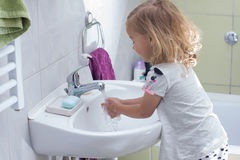 Little girl washing hands Stock Image