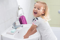Little girl washing hands Royalty Free Stock Image